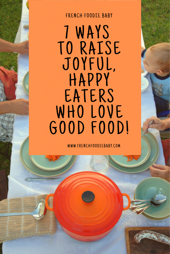 family at a dinner table, 7 ways to raise happy eaters who love good food