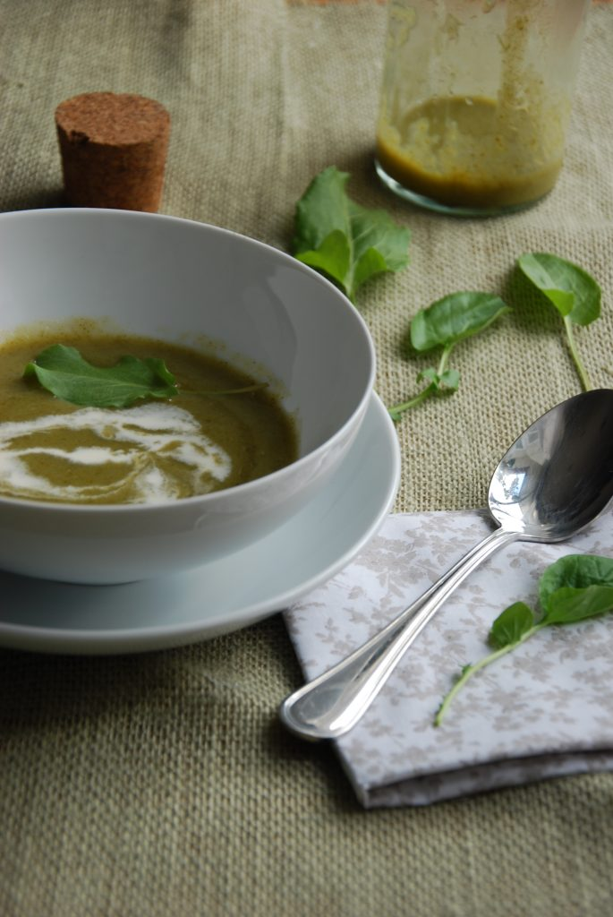 Green cream of watercress spoup in a bowl