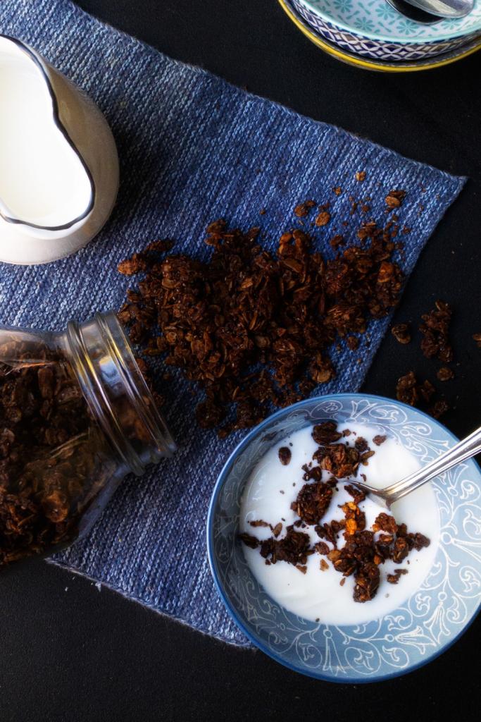 Bowl of homemade hazelnut chocolate granola in yogurt