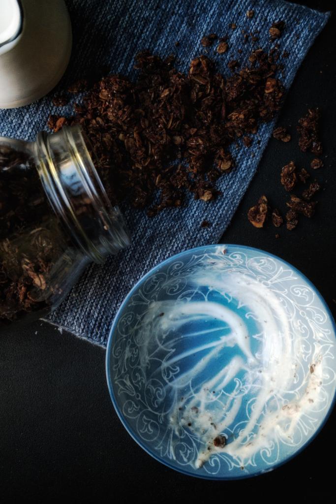 empty bowl with a jar of homemade chocolate hazelnut granola