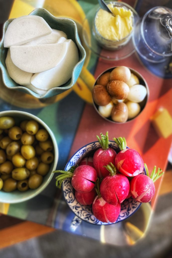 Easter Meal Appetizers: radishes, olives, hard boiled quail eggs and butter