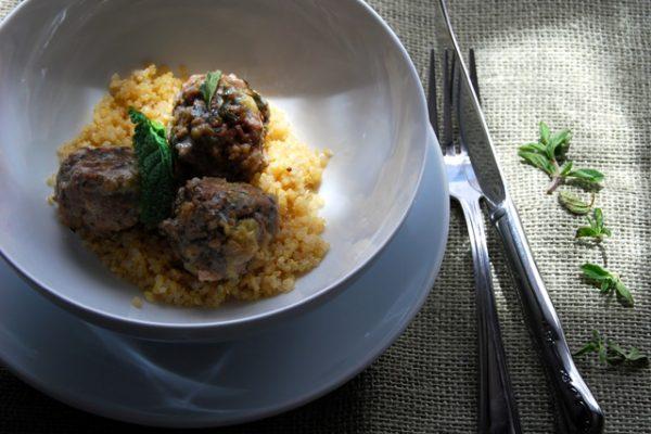 lamb meatballs in a bowl with quinoa
