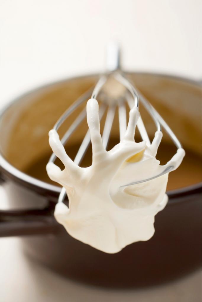 crème fraîche on a whisk